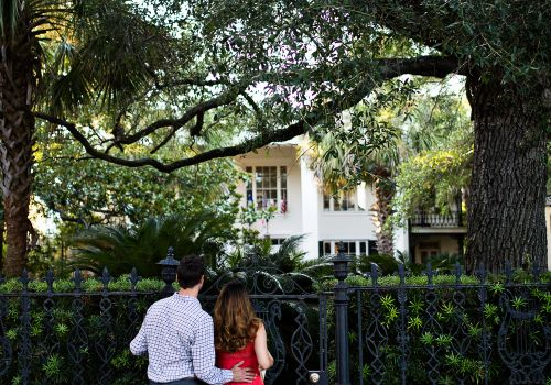 couple looking at historic Charleston buildings