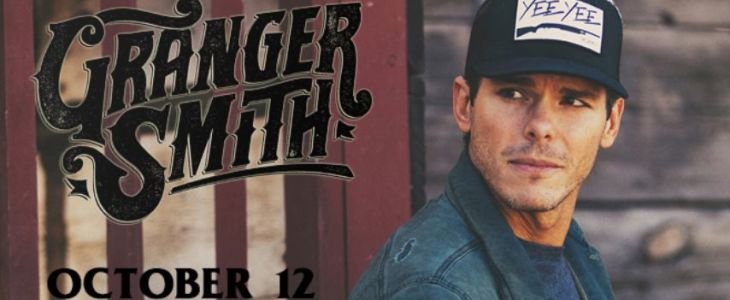 Granger Smith Standing In Front Of A Sign